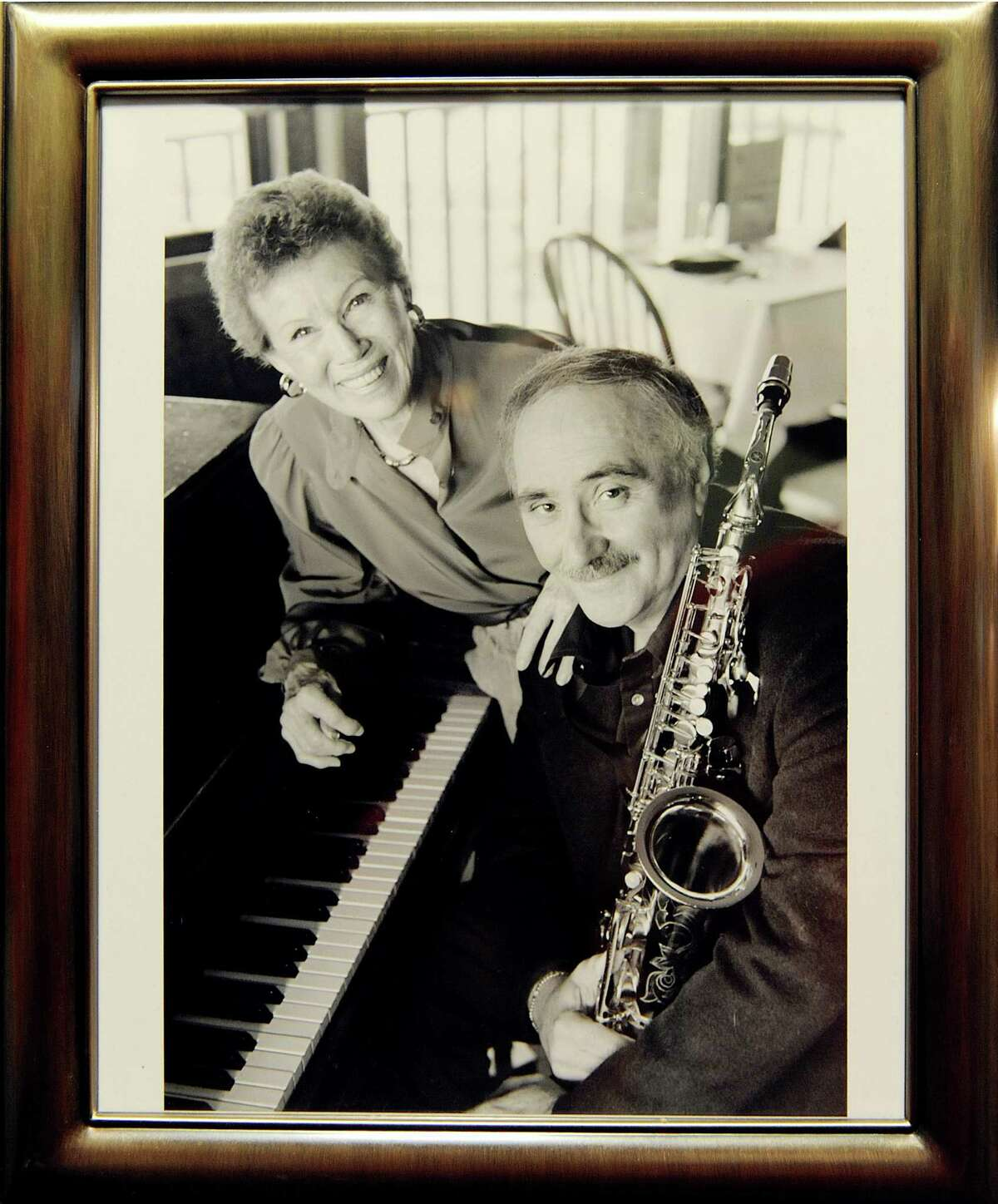 A copy of a photograph of Lee Shaw, left, with saxophone player Nick Brignola on Thursday, Nov. 8, 2012, at Shaw's home in Colonie, N.Y. (Cindy Schultz / Times Union)