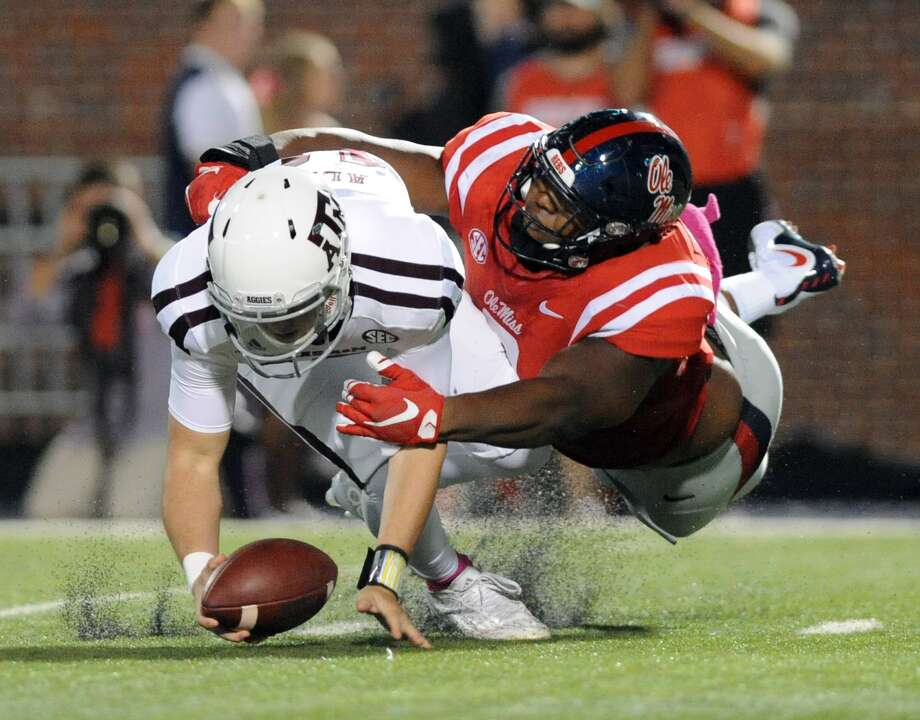 Ole Miss defensive lineman Breeland Speaks, making a tackle against Texas A&M in 2015, is a potential mid-round pick. Photo: Bruce Newman, Associated Press / OXFORD EAGLE