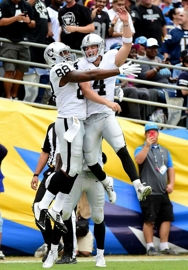 Oakland tight end Clive Walford (left) and quarterback Derek Carr get a jump on celebrating their touchdown connection. Photo: Harry How, Getty Images