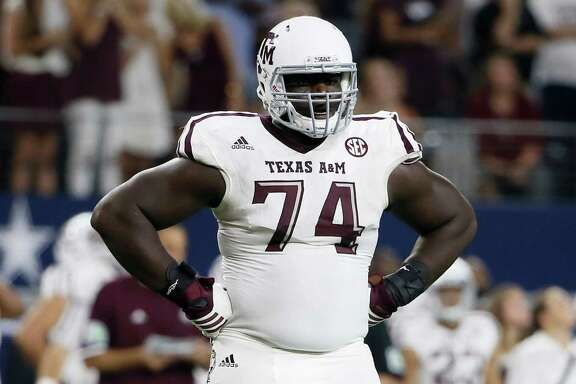 Texas A&M offensive lineman Germain Ifedi walks onto the field during an NCAA college football game against Arkansas Saturday Sept. 26, 2015, in Arlington, Texas. (AP Photo/Tony Gutierrez)