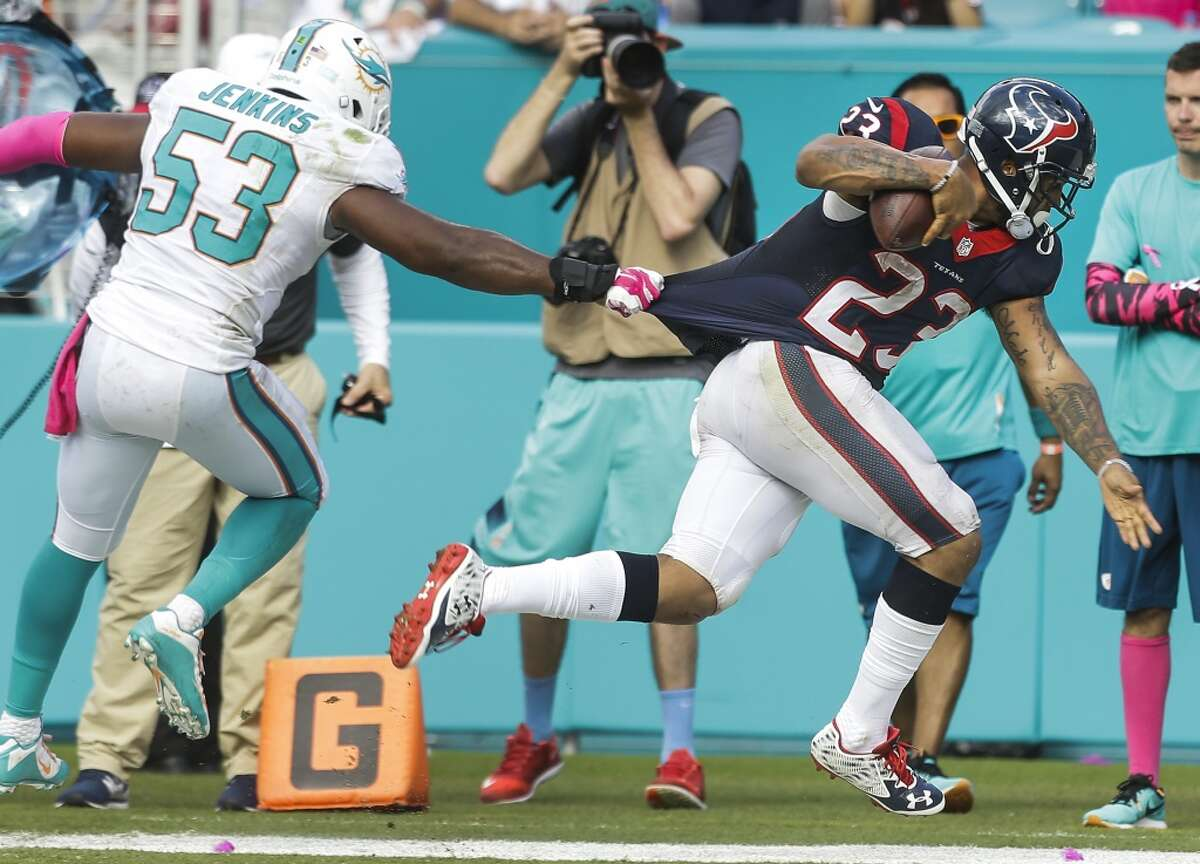 Houston Texans running back Arian Foster (23) crosses the goal line past Miami Dolphins outside linebacker Jelani Jenkins (53) for a 7-yard touchdown reception during the third quarter of an NFL football game at Sun Life Stadium on Sunday, Oct. 25, 2015, in Miami. ( Brett Coomer / Houston Chronicle )