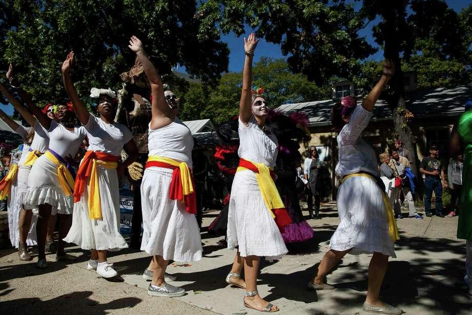 Dancers from the Austin Samba School perform during the Las Monas dance, drum and puppet procession at the Dia de Los Muertos festival Sunday Oct. 25, 2015 held at La Villita. Photo: Julysa Sosa/For The San Antonio