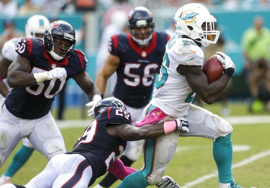 Miami Dolphins running back Lamar Miller (26) breaks away from Houston Texans strong safety Andre Hal (29) on his way to an 85-yard touchdown run during the second quarter of an NFL football game at Sun Life Stadium on Sunday, Oct. 25, 2015, in Miami. ( Brett Coomer / Houston Chronicle ) Photo: Brett Coomer, Houston Chronicle