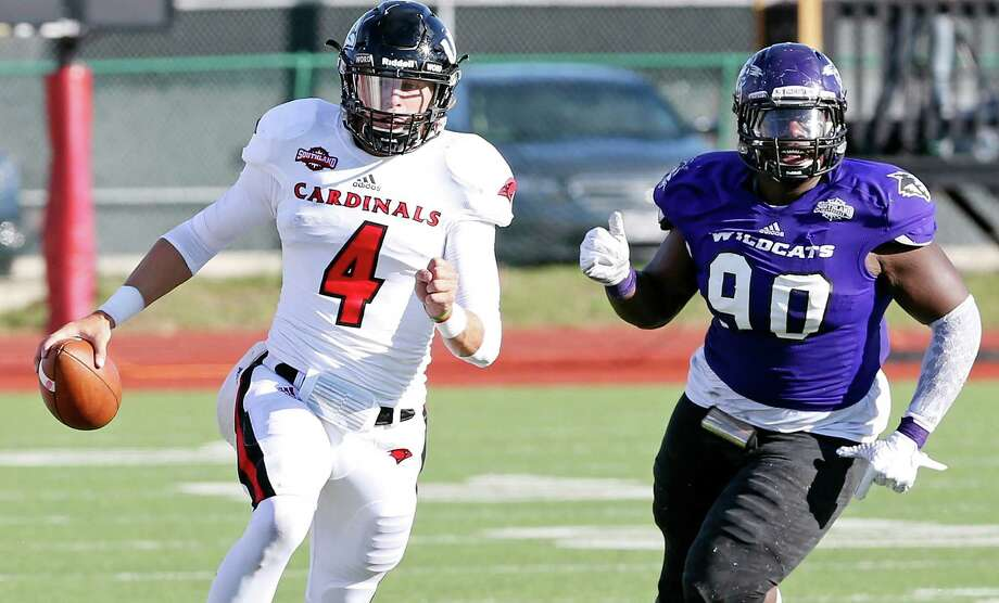 UIW quarterback Trent Brittain heads up field around Abilene Christian's LaMarcus Allen during the second half on Oct. 25, 2015 at Benson Stadium in San Antonio. UIW won 25-20. Photo: Edward A. Ornelas /San Antonio Express-News / © 2015 San Antonio Express-News