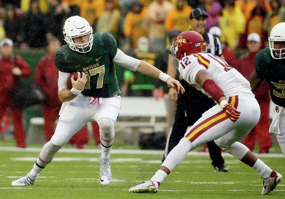 Baylor quarterback Seth Russell (17) scrambles out of the pocket as Iowa State linebacker Jarnor Jones (12) pursues in the first half of an NCAA college football game Saturday, Oct. 24, 2015, in Waco. Photo: Tony Gutierrez /Associated Press / AP