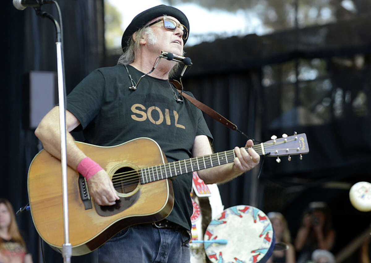 Neil Young performs during the 29th Annual Bridge School Benefit at Shoreline Amphitheatre on October 25, 2015 in Mountain View, California.