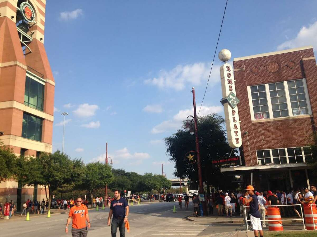 Astros fans leave Minute Maid Park after the team lost to the Kansas City Royals on Monday, Oct. 12. The post-season game was the second sold-out game in a row at the park.