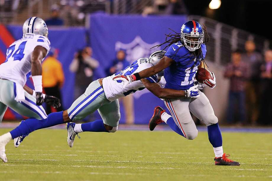 EAST RUTHERFORD, NJ - OCTOBER 25:  Dwayne Harris #17 of the New York Giants avoids the tackle attempt of Corey White #23 of the Dallas Cowboys during the fourth quarter at MetLife Stadium on October 25, 2015 in East Rutherford, New Jersey. The New York Giants defeated the Dallas Cowboys 27-20. (Photo by Elsa/Getty Images) Photo: Elsa, Staff / Getty Images / 2015 Getty Images