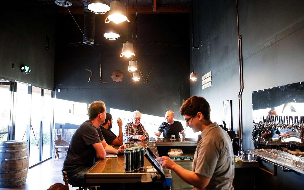 John Pazos, right, serves up customers at the bar at Plow in Santa Rosa, Calif., on Wednesday, October 21, 2015.