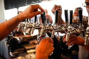 John Pazos pours beer at Plow in Santa Rosa, Calif., on Wednesday, October 21, 2015.