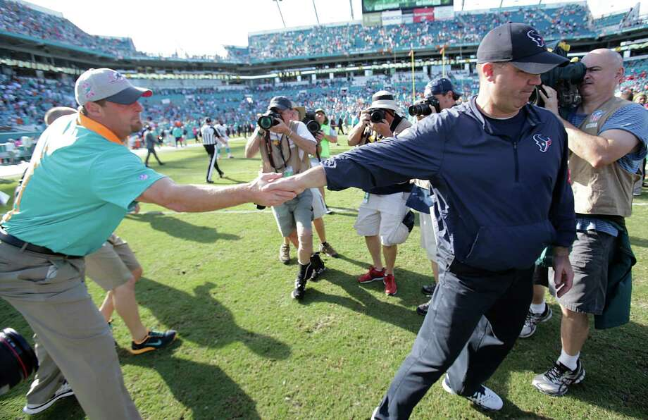 Houston Texans head coach Bill O'Brien and Miami Dolphins head coach Dan Campbell, greet each other at the end of an NFL football game, Sunday, Oct. 25, 2015 in Miami Gardens , Fla. The Dolphins defeated the Texans 44-26. (AP Photo/Wilfredo Lee) Photo: Wilfredo Lee, STF / Associated Press / AP