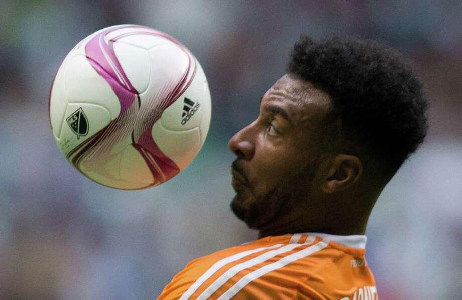 Houston Dynamo's Giles Barnes Photo: DARRYL DYCK, Associated Press / CP