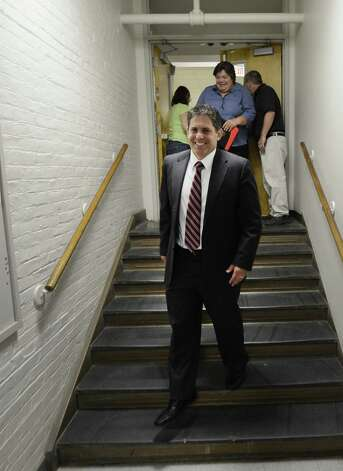 Larry Springs, Superintendent of the Schenectady School District on the job for his first day June 1, 2012 walks moves quickly between meetings in his offices in Schenectady, N.Y.       (Skip Dickstein / Times Union) Photo: Skip Dickstein / 00017908A
