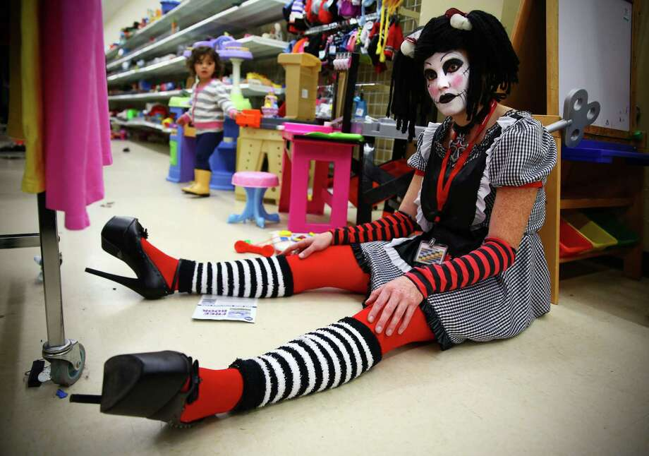 "Aliscia Fincannon models a ""goth rag doll"" costume at the Crown Hill Value Village, Sunday, Oct. 25, 2015.  Employees modeled under $25, last minute costume ideas. Photo: GENNA MARTIN, SEATTLEPI.COM / SEATTLEPI.COM"