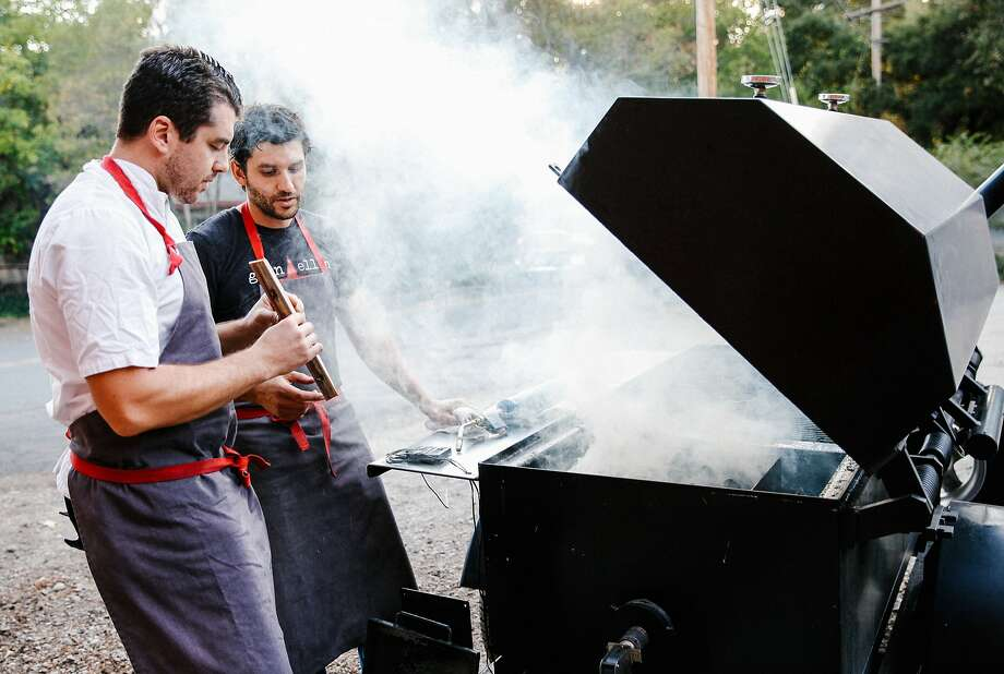 Chef Ari Weiswasser, left, and sous chef Louis Abruzzese light the smoker at Glen Ellen Star in Glen Ellen, Calif., on Thursday, October 22, 2015. Photo: Sarah Rice, Special To The Chronicle