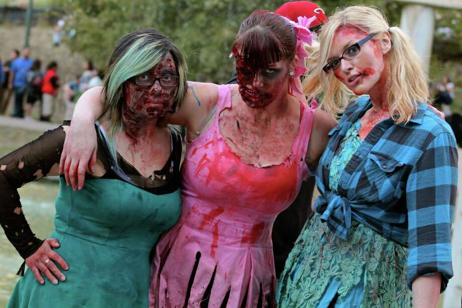 If you saw the undead walking about downtown and assaulting the Tower of the Americas on Sunday, relax, it was just the annual San Antonio Zombie Walk. Here's a look at all the gruesome fun. Photo: By Yvonne Zamora, For MySA.com,