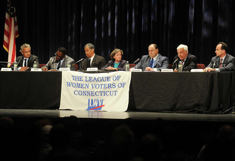 From left; Bridgeport mayoral candidates Enrique Torres, Anthony Barr, David Daniels, Mary-Jane Foster, Chris Taylor, Charles Coviello, and Joseph Ganim participate in a debate put on by The League of Women Voters of the Bridgeport Area at The Klein  Memorial Auditorium in Bridgeport, Conn. on Sunday, October 25, 2015. Photo: Brian A. Pounds / Hearst Connecticut Media / Connecticut Post