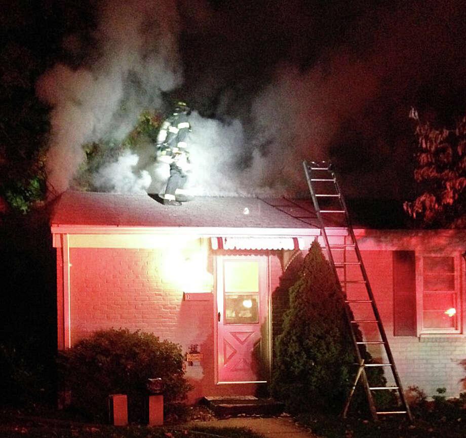 Firefighters battle an attic fire at a Berrylane Court duplex early Monday. Photo: Fairfield Fire Department / Fairfield Fire Department / Fairfield Citizen