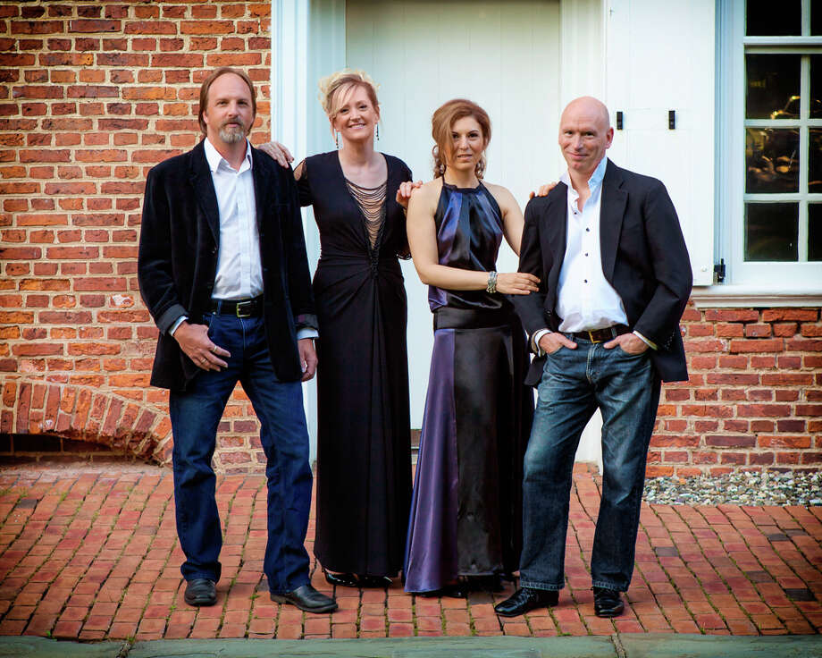 The Musicians of Ma'alwyck are Sten Yngvar Isachsen (guitar), left, Ann-Marie Barker Schwartz (director, violin), Petia Kassarova (violencello) and Norman Thibodeau (flute), as seen in this 2013 publicity photo.  (Courtesy the artists) / Optimum Exposure Photography