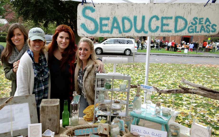 Michelle Kurtz, Kaila O'Malley, Erica DeVitto and Jenn Skiba at vendor booths for Seaduced Sea Glass and Riley & Madden Jewelry at the fall PopShop Market on Town Hall Green. Photo: Mike Lauterborn / For Hearst Connecticut Media / Fairfield Citizen