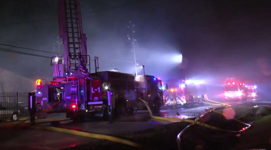 A man was rushed to the hospital Sunday night after he was rescued from a burning building in northwest Houston.  The 2-alarm fire broke about 9:30 p.m. at an automobile restoration business on Ruland near Campbell, according to the Houston Fire Department. Photo: Metro Video