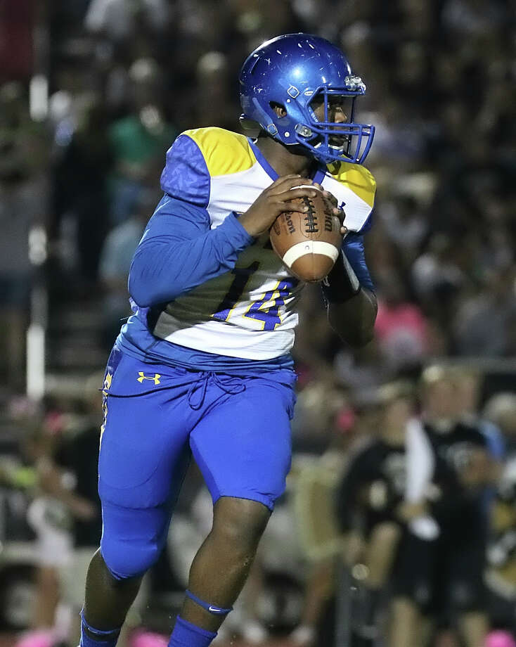 Josh Boyd looks to pass during the game between the Ozen Panthers and the Vidor Pirates at Pirate Stadium in Vidor, Friday October 9th, 2015 - photo provided by Kyle Ezell