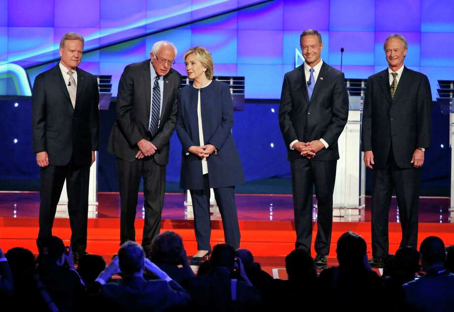 With Hillary Clinton taking center stage, the Democratic presidential candidates line up for their recent debate. A reader says GOP Photo: John Locher /Associated Press / AP