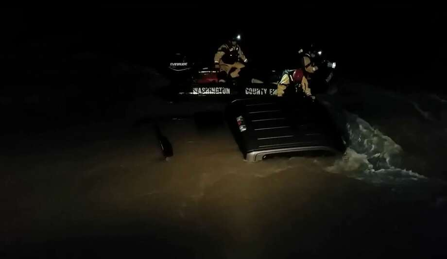 Dramatic video footage shows rescue workers in North Texas pulling a man and dog from a submerged pickup truck during heavy flooding that hit the region over the weekend. Photo: YouTube/James Reed/Texas Task Force 1