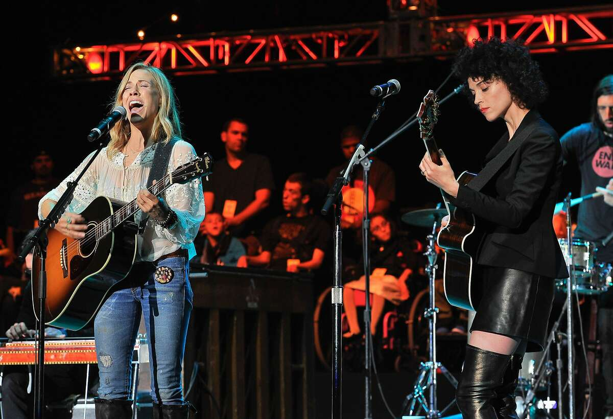 (Left to right) Sheryl Crow and Annie Clark (AKA) St. Vincent perform at the 29th Annual Bridge School Benefit concert at Shoreline Amphitheatre on October 25, 2015 in Mountain View, California.