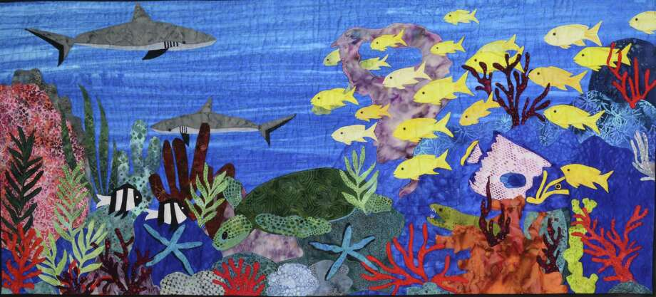 This landscape quilt by Sue Bynum depicts the National Park of American Samoa. Photo: Picasa