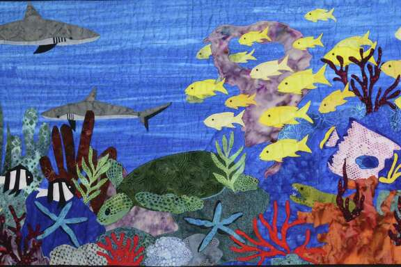 This landscape quilt by Sue Bynum depicts the National Park of American Samoa.