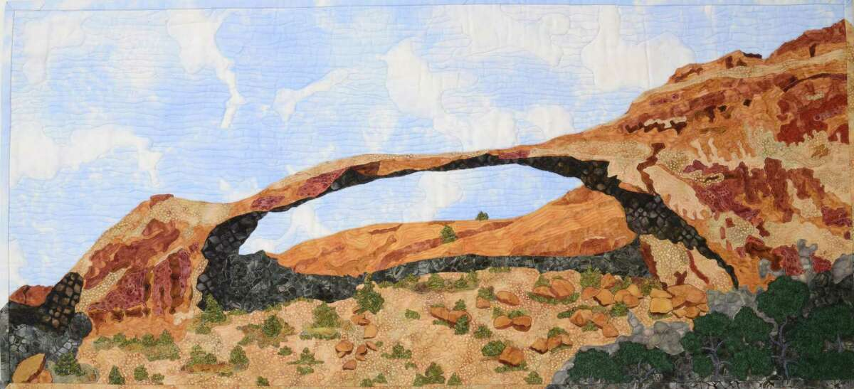 This landscape quilt by Etta McFarland depicts Arches National Park in eastern Utah.