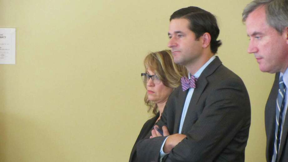 From left, Dawn LaCarte, defense attorney James Tyner and Assistant Attorney General Christopher Baynes. (Bob Gardinier / Times Union)