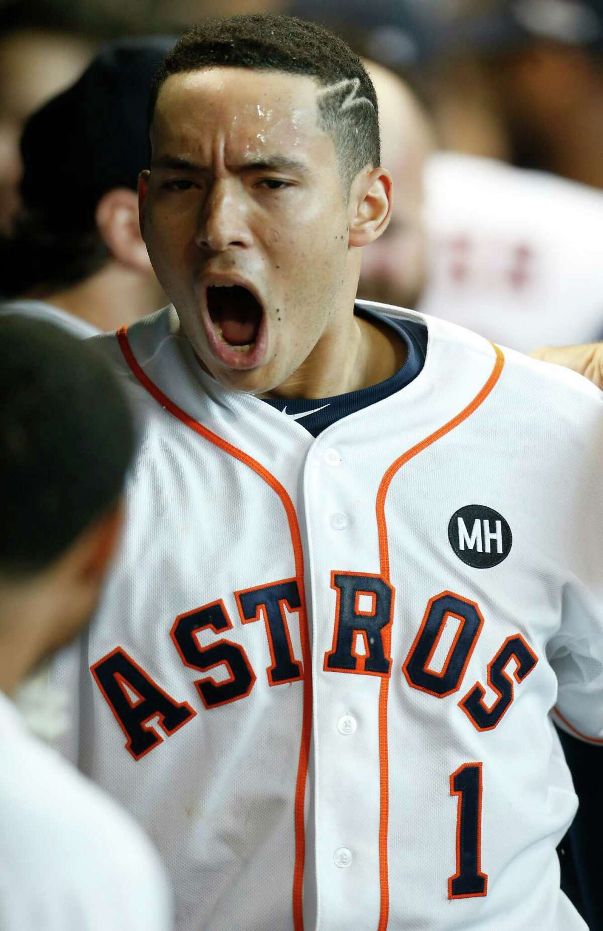 Houston Astros shortstop Carlos Correa (1) yells in the dugout after hitting a home run off Kansas City Royals reliever Ryan Madson during the seventh inning of Game 4 of the American League Division Series at Minute Maid Park on Monday, Oct. 12, 2015, in Houston. ( Karen Warren / Houston Chronicle )