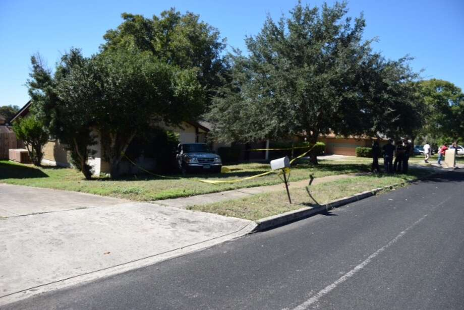 Police believe a man found dead in a truck that had struck a house on the Southwest Side Monday morning suffered a medical emergency prior to the crash. Photo: By Mark D. Wilson/San Antonio Express-News