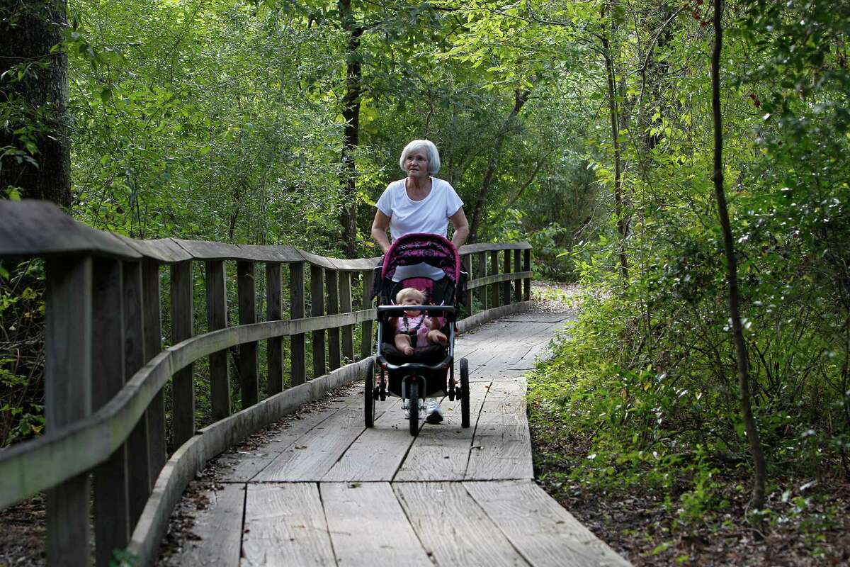 Glenna Herron pushes her 9-month-old granddaughter, Ella, along a trail at the Houston Arboretum & Nature Center.
