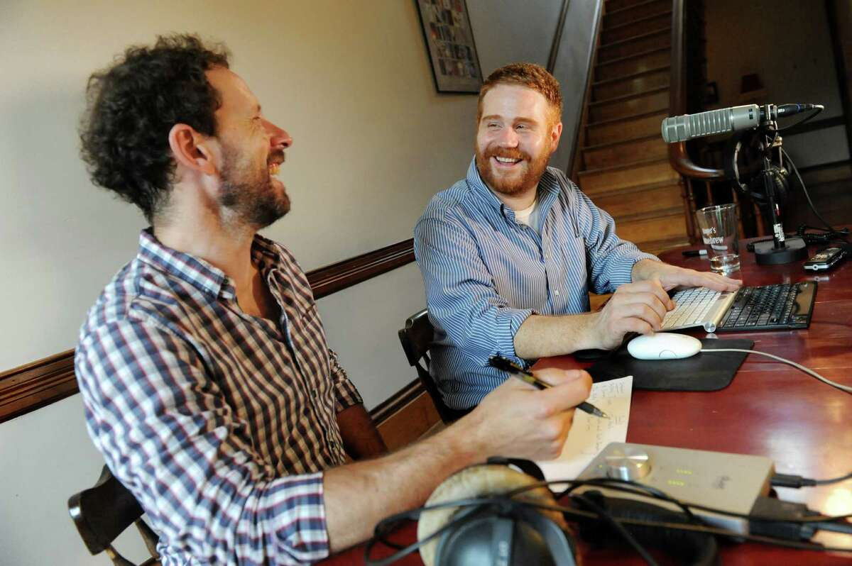 Creator and host Duncan Crary, right, and engineer Ian White work on an episode of