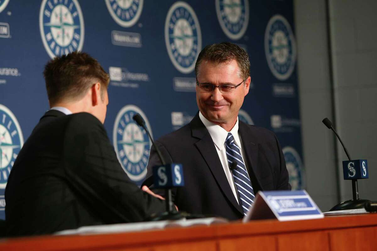 General manager Jerry Dipoto (left) introduces Scott Servais as the new manager for the Seattle Mariners. Photographed Monday, Oct. 26, 2015.