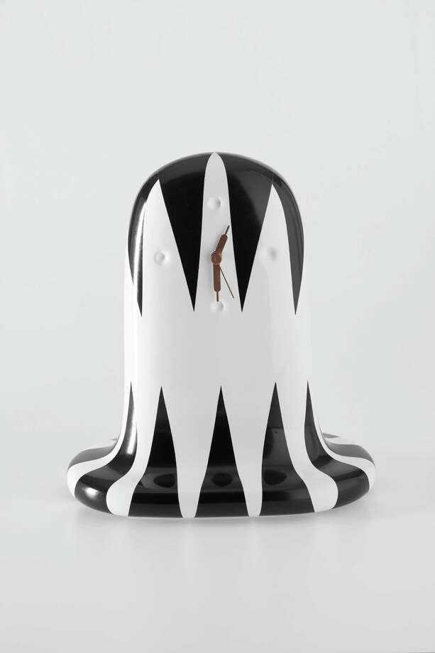 The Fantasmiko clock, $419, is ceramic and 12 inches tall. It has a ghost-like silhouette and is handpainted in several black-and-white patterns. Photo: Cantoni