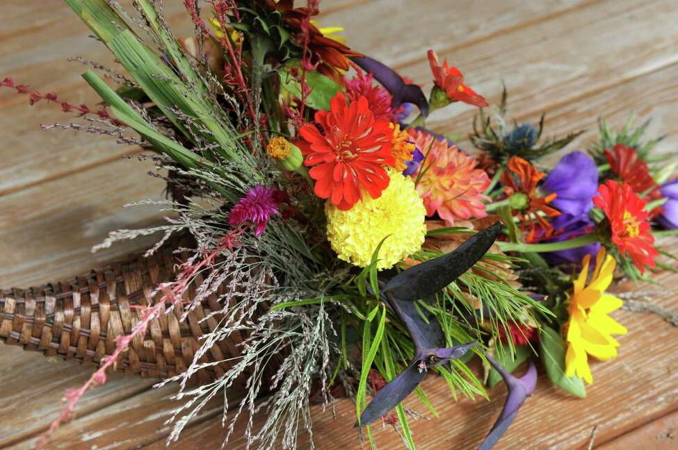 Floral cornucopia with sunflowers, zinnia, dahlia, lisianthus and more on Tuesday, Sept. 22, 2015, at Native Farm Flowers in Greenfield Center, N.Y. (Cindy Schultz / Times Union)