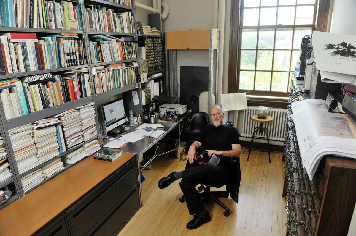 RPI associate professor of Architecture, Ted Krueger poses in his office on the college campus on Wednesday, Sept. 16, 2015, in Troy, N.Y. Krueger is holding a novel electromagnetic sensor built into a hat that he is working on. (Paul Buckowski / Times Union)