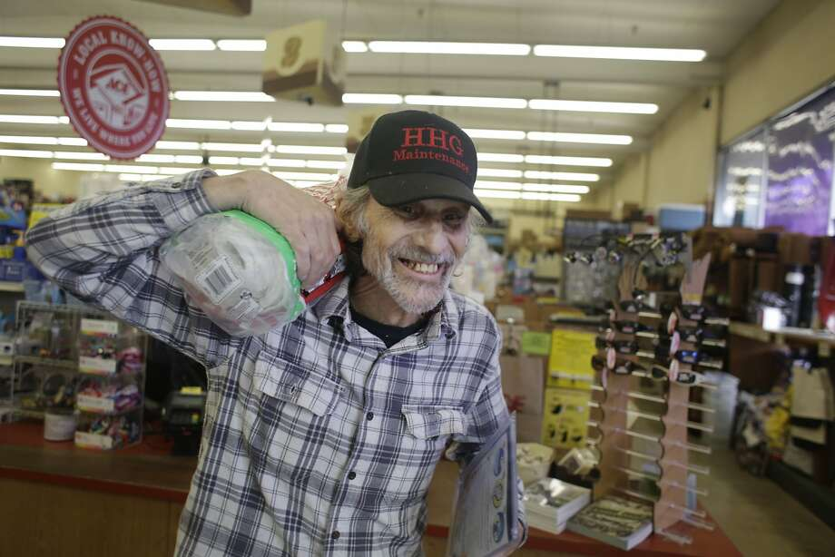 Harry Hamilton carries a roll of plastic sheeting after purchasing it at Grand Lake Ace Hardware on Monday, October 26,  2015 in Oakland, Calif. Photo: Lea Suzuki, The Chronicle