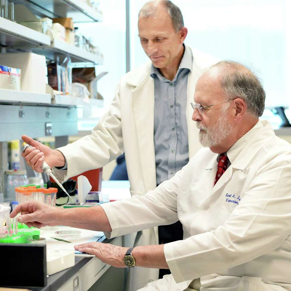 Professor Igor K. Lednev of UAlbany's Department of Chemistry, left, and Dr. Earl A. Zimmerman, director of the Alzheimer Center of Albany Medical Center's Dept. of Neurology at work in Lednev's research lab at UAlbany Thursday Sept. 3, 2015 in Albany, NY. (John Carl D'Annibale / Times Union)