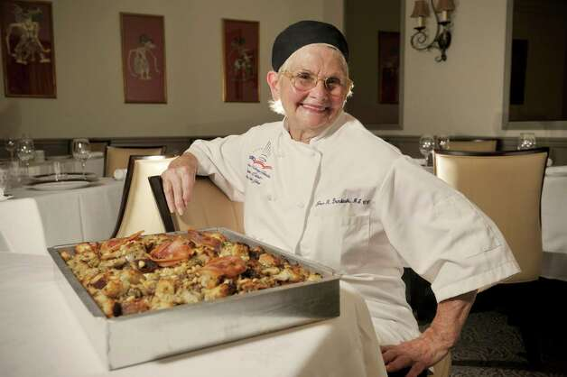 Yono's pastry chef, Joan R. Dembinski, poses with a Thanksgiving dressing dish she made  at Yono's on Thursday, Sept. 17, 2015, in Albany, N.Y.  The classic Italian dish is made with Italian sausage, Pereccs's bread from Schenectady, pancetta, pine nuts and italian spices.  Dembinski's mother, Josephine always made the dish and Dembinski learn it from her.   (Paul Buckowski / Times Union) Photo: PAUL BUCKOWSKI / 00033376A