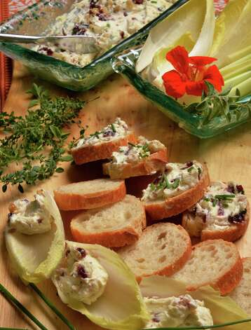 Dale Miller's Cranberry walnut goat cheese Boursin spread on endive and french bread at his home Thursday Sept. 17, 2015 in Clifton Park.  (John Carl D'Annibale / Times Union) Photo: John Carl D'Annibale / 00033377A