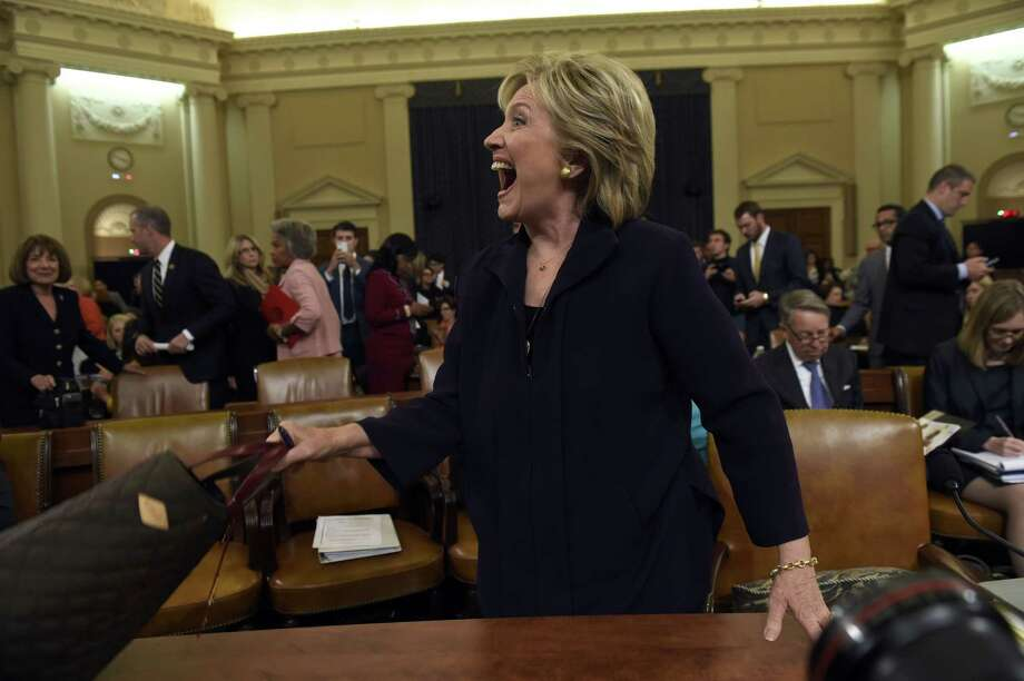 TOPSHOTS Former Secretary of State and Democratic Presidential hopeful Hillary Clinton testifies before the House Select Committee on Benghazi on Capitol Hill in Washington, DC, October 22, 2015. Clinton took the stand Thursday to defend her role in responding to deadly attacks on the US mission in Libya, as Republicans forged ahead with an inquiry criticized as partisan anti-Clinton propaganda.   AFP PHOTO / SAUL LOEBSAUL LOEB/AFP/Getty Images ORG XMIT: 566985077 Photo: SAUL LOEB / AFP