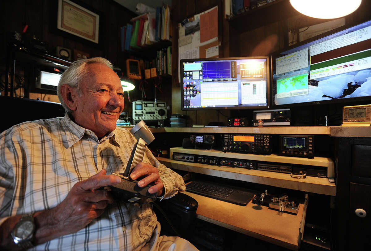 Ham radio operator Bruce Moore chats with other enthusiasts around the world from his