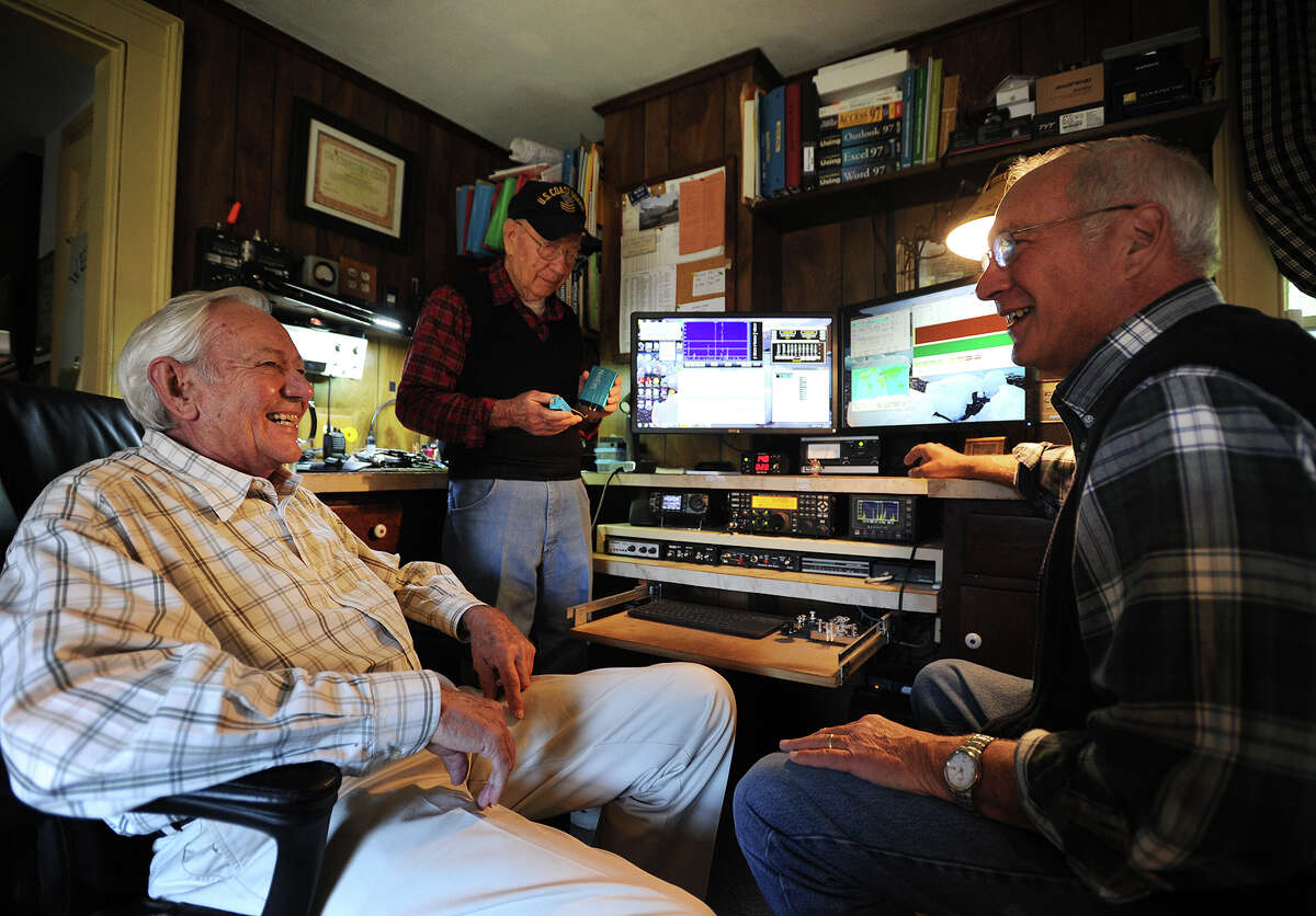 From left; Ham radio enthusiasts Bruce Moore, Bill Britt, of Fairfield, and Joel Hallas, of Westport, meet in Moore's