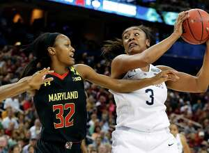 TAMPA, FL - APRIL 05:  Morgan Tuck #3 of the Connecticut Huskies goes up against Shatori Walker-Kimbrough #32 of the Maryland Terrapins in the first half during the NCAA Women's Final Four Semifinal at Amalie Arena on April 5, 2015 in Tampa, Florida.  (Photo by Mike Carlson/Getty Images)
