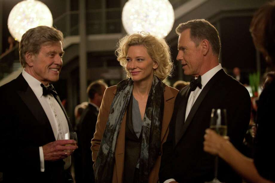 """In this image released by Sony Pictures Classics, Robert Redford portrays Dan Rather, from left, Cate Blanchett portrays Mary Mapes and Bruce Greenwood portrays Andrew Heyward in a scene from, """"Truth."""" (Lisa Tomasetti /Sony Pictures Classics via AP) Photo: Lisa Tomasetti, Associated Press / Sony Pictures Classics"""
